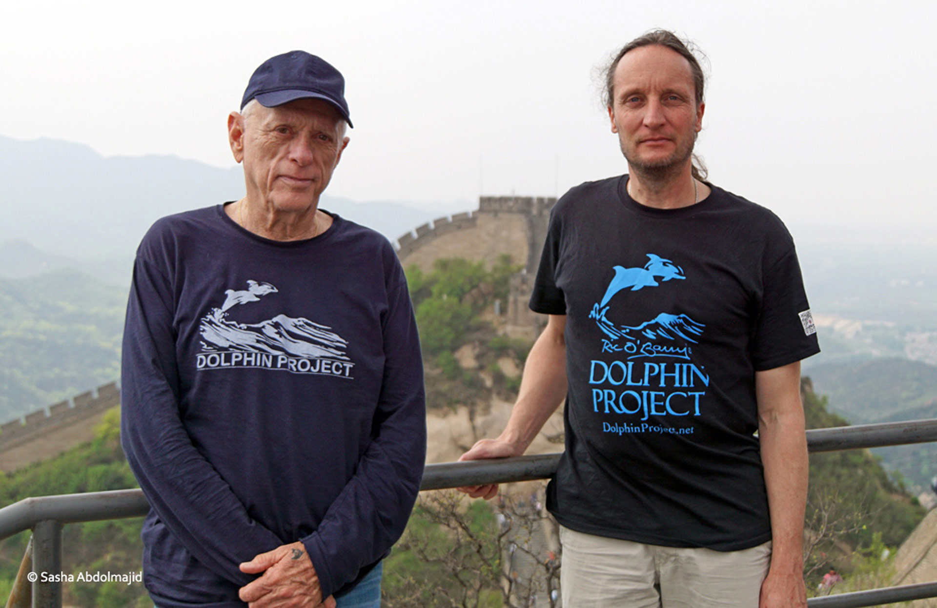 Ric O'Barry and Hans Peter Roth atop the Great Wall of China. Photo: Sasha Abdolmajid