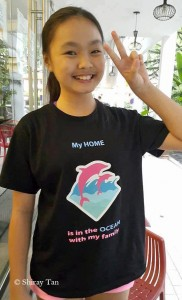 Shiray Tan proudly presenting her stand - anti dolphin captivity